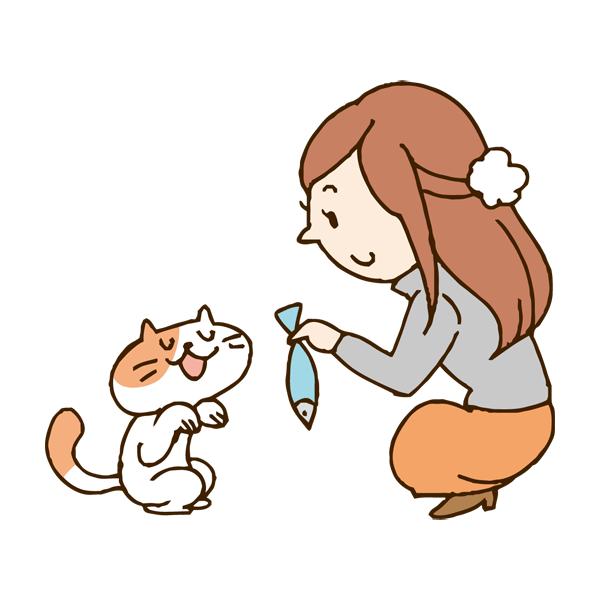 ネコに魚をあげる女性