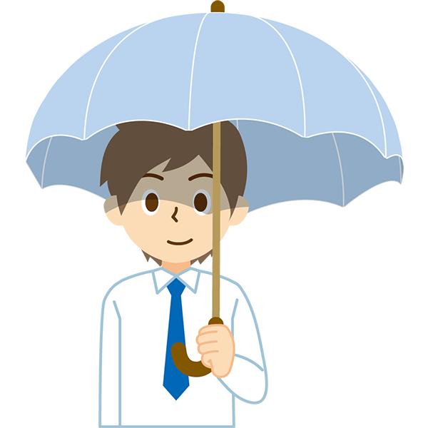 日傘をさす会社員男性